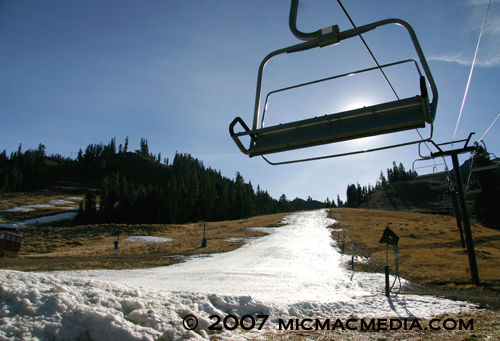 Snowmaking empty chair logo Squaw